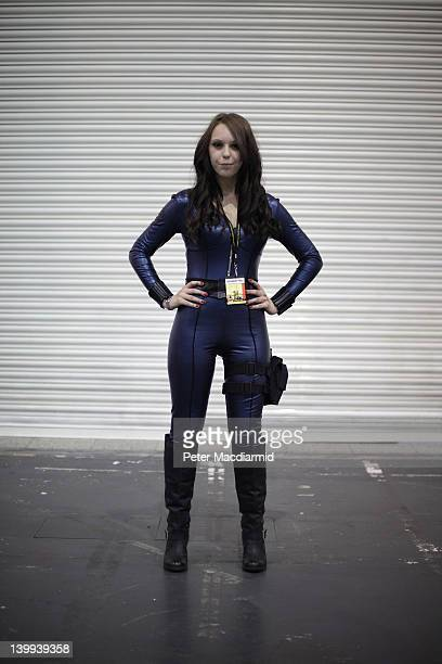 A visitor to the London Super Comic Convention wears a Black Widow costume at ExCel on February 25 2012 in London England Visitors to the Comic...