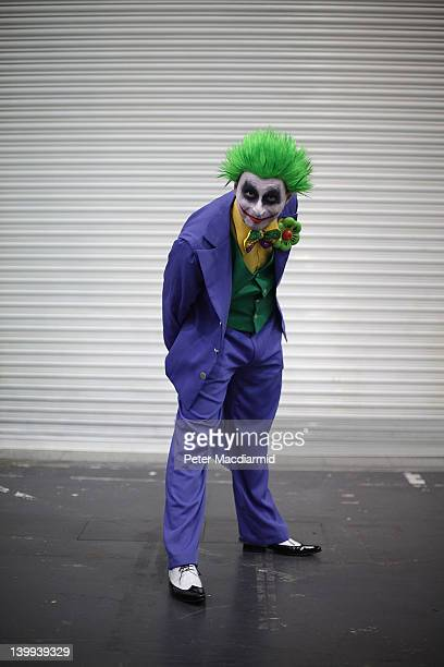 A visitor to the London Super Comic Convention wears a Joker costume at ExCel on February 25 2012 in London England Visitors to the Comic Convention...