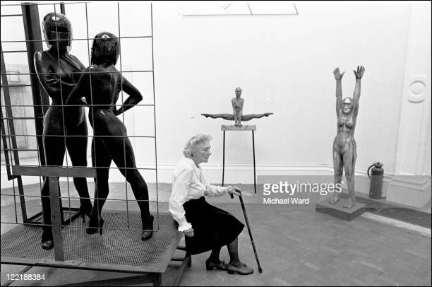 A visitor to the Royal Academy Summer Exhibition rests between sculptures 1982