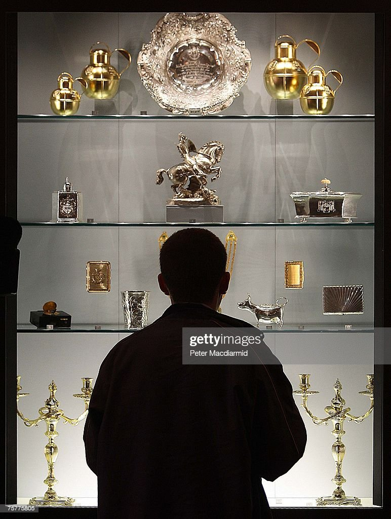 A visitor to the 'Royal Wedding: 20 Novermber 1957' exhibition looks at a selection of gifts given to the royal couple at Buckingham Palace on July 27, 2007 in London. Queen Elizabeth II will be the first reigning sovereign to celebrate a 60th wedding anniversary. This new exhibition will mark the occasion by recreating the day in 1947 when Princess Elizabeth married The Duke of Edinburgh at Westminster Abbey. The collection of archive film footage, behind the scenes preparations, dresses, jewels and gifts reflect the mood of public rejoicing that swept the nation in the immediate aftermath of World War II.