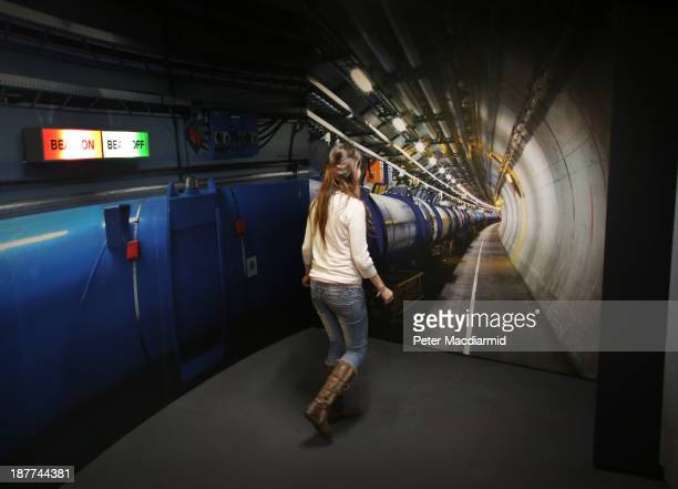 A visitor to the Science Museum walks towards a photograph of the workings of the Large Hadron Collider at the 'Collider' exhibition on November 12...