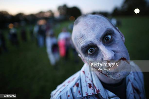 A visitor to the Shocktober Fest dressed as zombie poses at Tulleys Farm on October 6 2012 in Turners Hill England People dressed as zombies from...