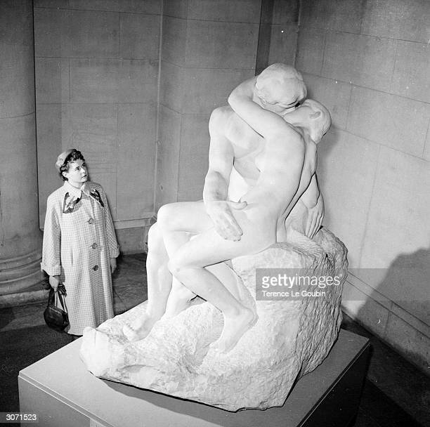 A visitor to the Tate Gallery in London admires one of the three marble originals of Auguste Rodin's 'The Kiss' The statue's owner has announced...