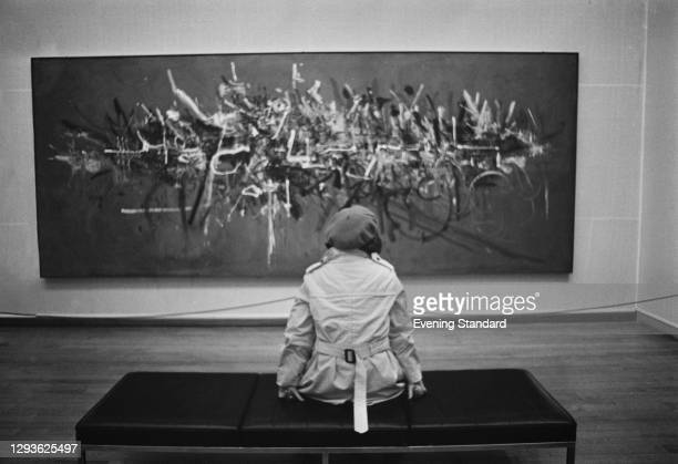 Visitor to the Tate Gallery in London, viewing a piece of abstract expressionist art, UK, 18th October 1967.