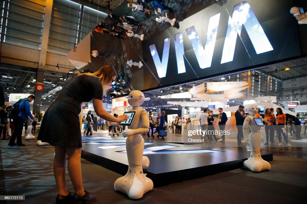 A visitor touches a 'Pepper' humanoid robot developed by the French company Aldebaran and the Japanese group Softbank during the Viva Technology show at Parc des Expositions Porte de Versailles on May 24, 2018 in Paris, France. Viva Technology, the new international event brings together 5,000 startups with top investors, companies to grow businesses and all players in the digital transformation who shape the future of the internet.