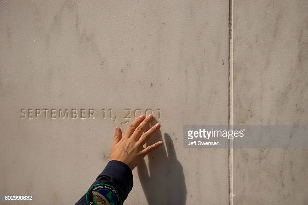 A visitor traces the date etched in a marble slab on the Wall of Names at the Flight 93 National Memorial before the 15th Anniversary of the...