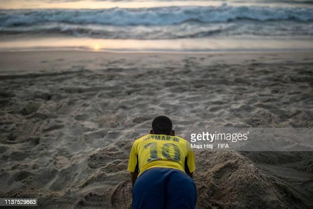 Visitor trains near the beach on January 16 2019 in Dakar Senegal