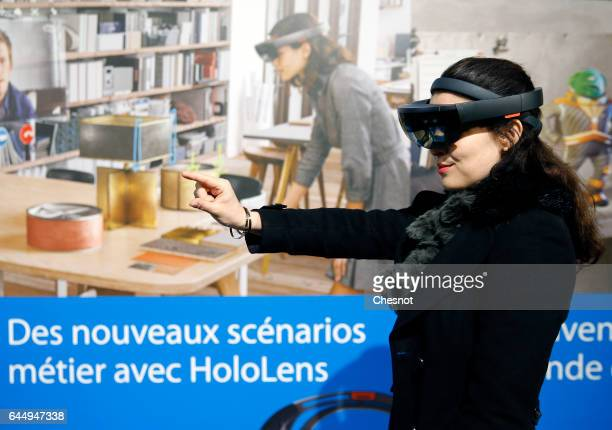 A visitor tries a virtual reality headset Microsoft HoloLens during the show 'Virtuality Paris 2017' on February 24 2017 in Paris France Microsoft...