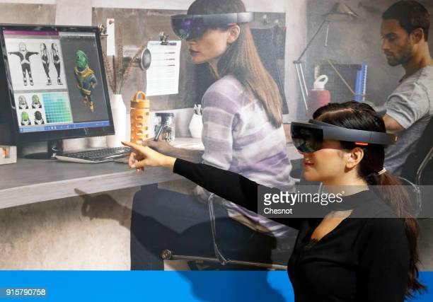 A visitor tries a virtual reality headset Microsoft HoloLens during the 'Virtuality Paris 2018' show on February 08 2018 in Paris France Microsoft...