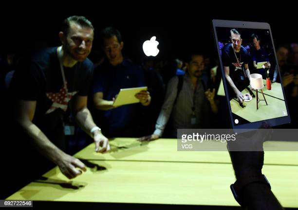 A visitor tries Apple iPad Pro during the 2017 Apple Worldwide Developer Conference at San Jose Convention Center on June 5 2017 in San Jose...