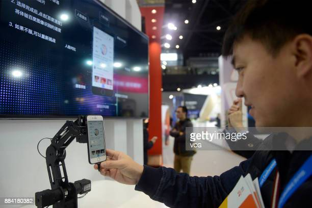 A visitor tries face recognition system at the Light of the Internet Exposition as part of the fourth World Internet Conference at Wuzhen...
