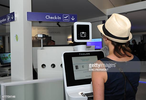 RANDOLPH A visitor tries French manufacturer Thales'border control system with automated biometric at the International Paris Airshow at Le Bourget...