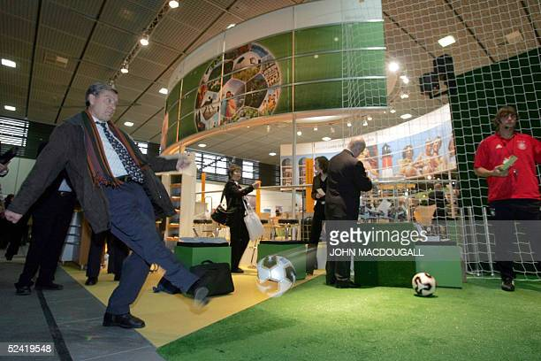 A visitor tries his luck at scoring a goal at a stand advertising the 2006 Football World Cup hosted by Germany at Berlin's International Tourism...
