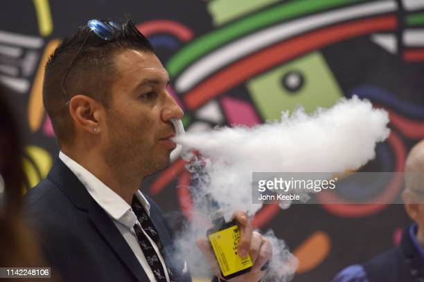 A visitor tries out a flavoured Eliquid vape during Vape Jam 2019 at ExCel on April 12 2019 in London England Vape Jam UK the premier Electronic...
