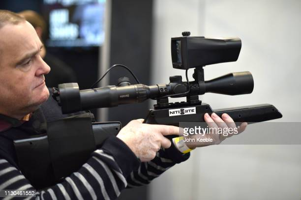 A visitor tries out a NiteSite night vision system riflescope at the Great British Shooting Show at NEC Arena on February 15 2019 in Birmingham...