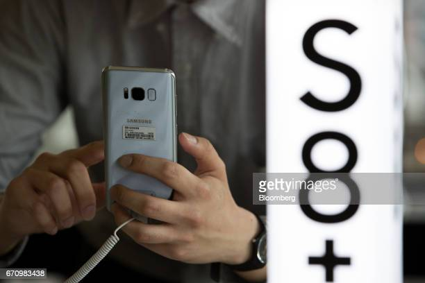 A visitor tries out a Samsung Electronics Co Galaxy S8 smartphone at KT Corp's Olleh Square flagship store in Seoul South Korea on Friday April 21...