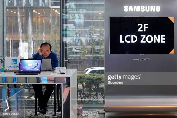 A visitor tries out a Samsung Electronics Co Series 9 Notebook at the Samsung d'light showroom and store in Seoul South Korea on Wednesday Jan 23...