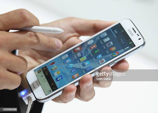 A visitor tries out the new Samsung Galaxy Note II smartphone at the Samsung stand at the IFA 2012 consumer electronics trade fair on August 30 2012...