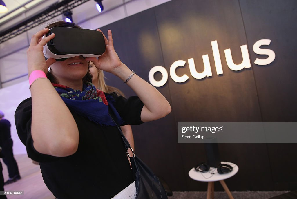 A visitor tries out the Oculus Gear VR virtual reality goggles at the Facebook Innovation Hub on February 24, 2016 in Berlin, Germany. The Facebook Innovation Hub is a temporary exhibition space where the company is showcasing some of its newest technologies and projects.