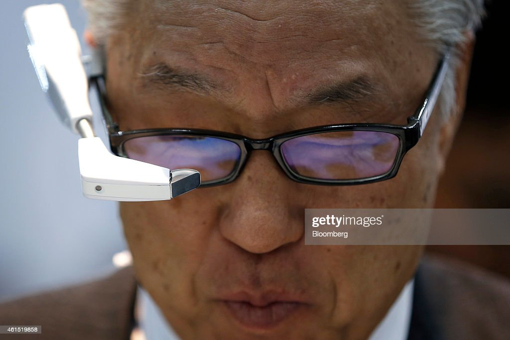 A visitor tries out Weatunitis Co.'s InfoLinker wearable device at the Wearable Expo in Tokyo, Japan, on Wednesday, Jan. 14, 2015. The world largest expo for wearable devices and technologies will be held through Jan. 16. Photographer: Kiyoshi Ota/Bloomberg via Getty Images