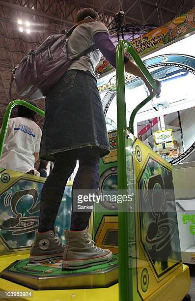 A visitor tries Sega's 'UFO Balance Catcher' during the 48th Amusement Machine Show at Makuhari Messe on September 9 2010 in Chiba Japan The show...