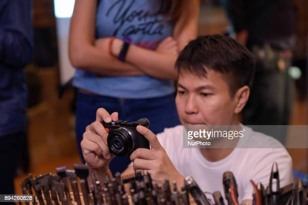 A visitor tries the new Leica CL camera at an event in Kuala Lumpur Malaysia on December 16 2017