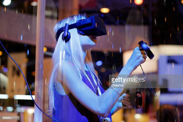 A visitor tries the Oculus Gear VR headset to experience 3D virtual reality during the Viva Technology show on June 16 2017 in Paris France Viva...