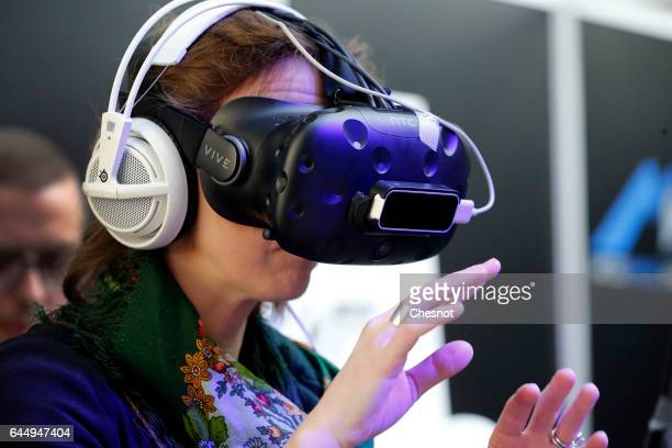 A visitor tries the virtual reality headset 'HTC vive' to experience 3D virtual reality during the show 'Virtuality Paris 2017' on February 24 2017...