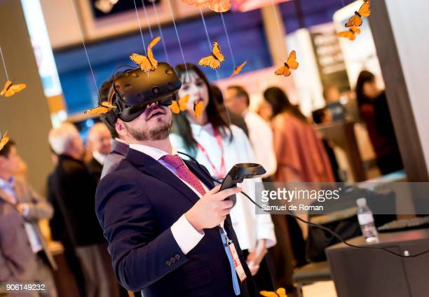 Visitor trying 3D googles mexican butterfly at the Mexico stand at FITUR International Tourism Fair 2018 at Ifema on January 17 2018 in Madrid Spain...