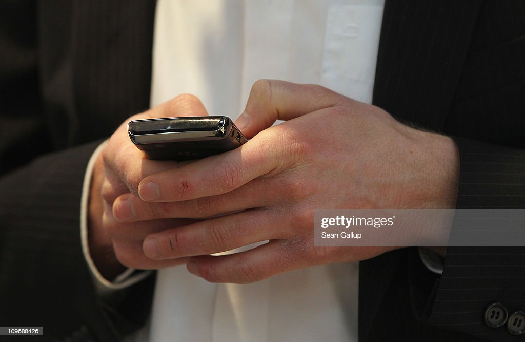 A visitor types with his thumbs on a Blackberry smart phone at the CeBIT technology trade fair on March 1, 2011 in Hanover, Germany. CeBIT 2011 will be open to the public from March 1-5.