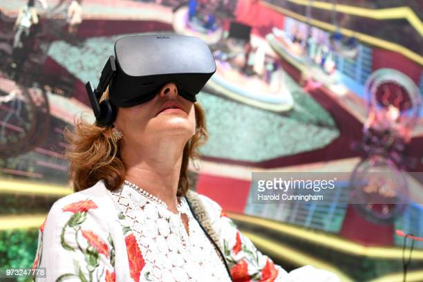 A visitor uses a virtual reality headset to view the artwork of Jacolby Satterwhite 'Domestika' during the press preview for Art Basel at Basel Messe...