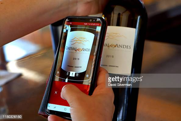 A Visitor Uses The Vivino Mobile Phone Application For More