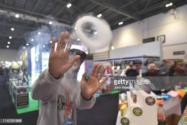 A visitor vapes and blows a smoke ring during Vape Jam 2019 at ExCel on April 13 2019 in London England Vape Jam UK the premier Electronic Cigarette...