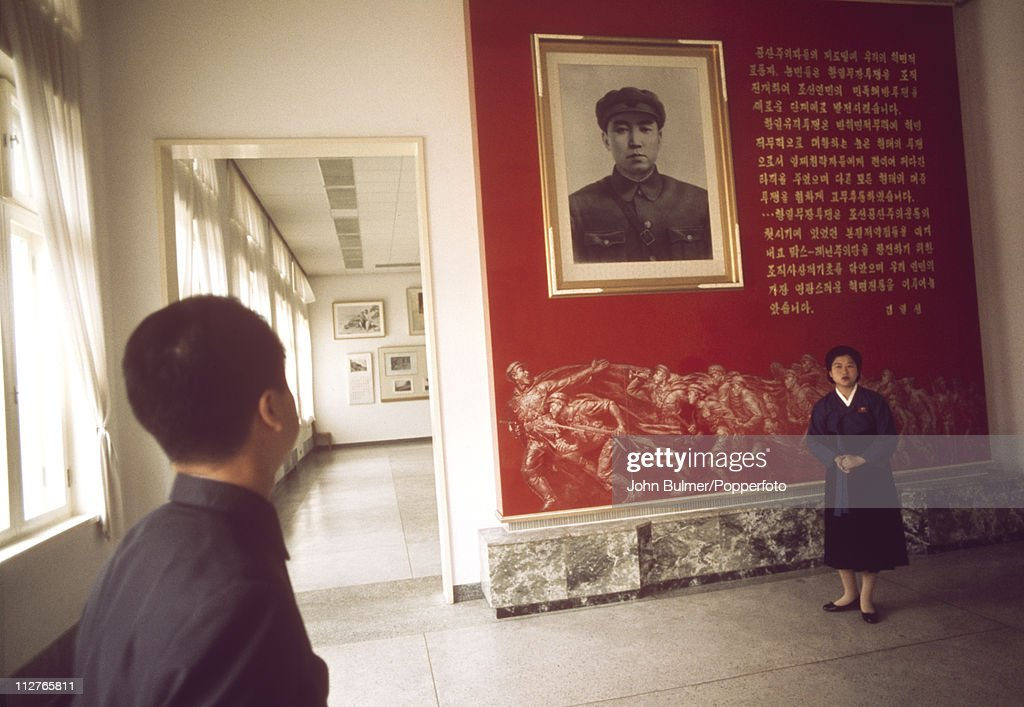 A visitor viewing a portrait of Communist leader Kim Il-sung at the Revolutionary Museum of Culture, Pyongyang, North Korea, February 1973.