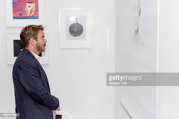 Visitor viewing artwork at Clen Gallery Art Exhibition at Rogue Space on October 17 2013 in New York City