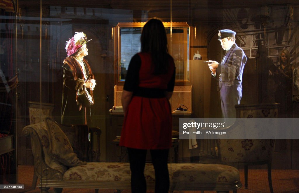 A visitor views a interactive hologram feature inside the
