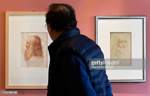 A visitor views a portrait of Leonardo Da Vinci by Francesco Melzi and a Da Vinci selfportrait at the Leonardo Da Vinci museum during an exhibition...