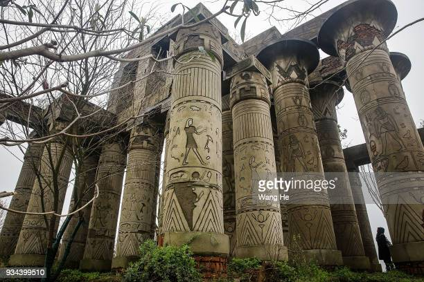 A visitor views a replica of the Karnak Temple in Egypt at the abandoned Wanguo Park on March 19 2018 in Wuhan Hubei provinceThe park replicas were...
