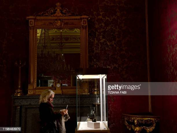 A visitor views a sculpture during the exhibition Worn by the Gods at the Fashion and Costume Museum in Palazzo Pitti in Florence on January 30 2020...