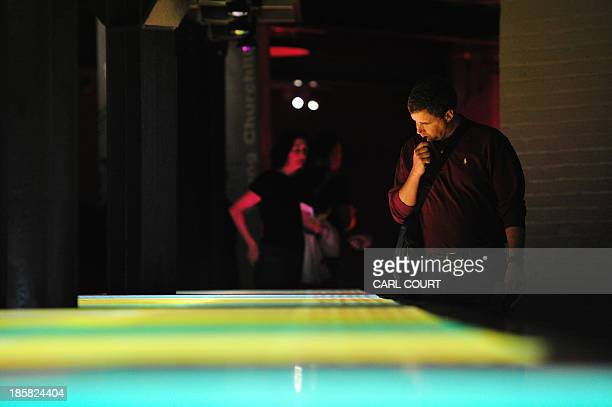 A visitor views an exhibit as he looks for 'spy bugs' at the Churchill War Rooms in central London on October 4 during the 'Secrets and Spies' event...