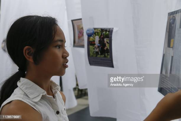 A visitor views an information document on the wall during a commemoration event to mark the 5th anniversary of the missing Malaysia Airlines MH370...