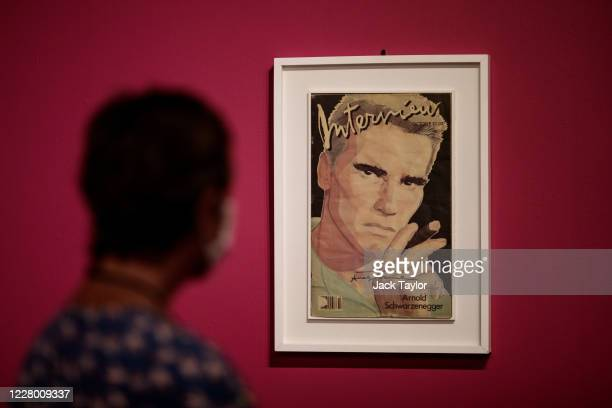 A visitor views Andy Warhol's 1985 Interview Magazine Cover featuring Arnold Schwarzenegger at the 'Andy Warhol Pop Art' exhibition at the RCB...