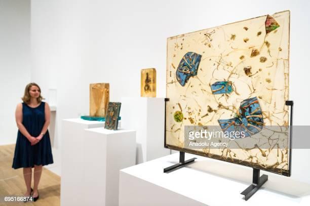 Visitor views artwork titled The Man of All Times Paleokrystalos, 1969 ; Paleokrystalos, 1960s ; Moon Drops, 1967 by artist Fahrelnissa Zeid is shown...