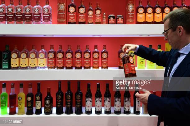 A visitor views bottles of Amaretto on May 8 2019 at the TUTTOFOOD fair the international B2B show dedicated to food and beverage and organised by...