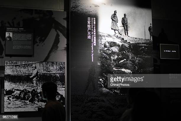A visitor views documents at the Memorial Hall of the Victims in the Nanjing Massacre as tens of thousands of people come to mourn victims a day...