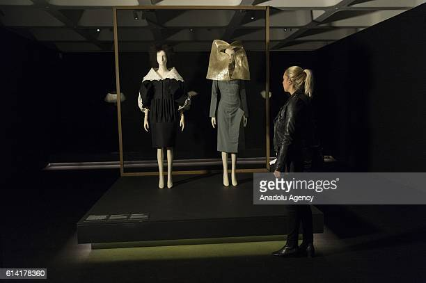 Visitor views dresses by fashion designer Alexander McQueen on display as part of The Vulgar Fashion Redefined exhibition charting the vulgarity and...