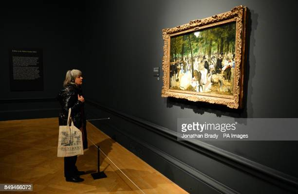 A visitor views Edouard Manet's 'Music in the Tuileries Gardens' during a press view of 'ManetPortraying Life' the first major exhibition in the UK...