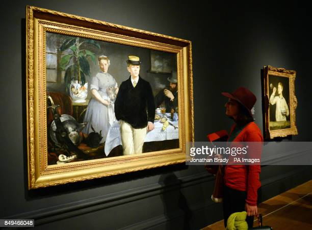 A visitor views Edouard Manet's 'The Luncheon' during a press view of 'ManetPortraying Life' the first major exhibition in the UK to showcase Edouard...