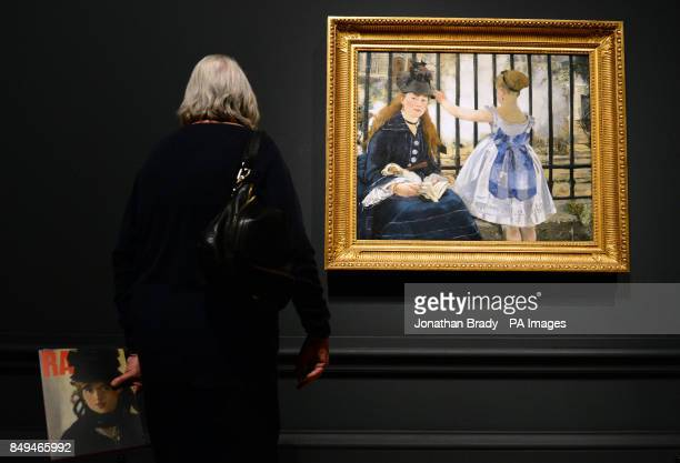 A visitor views Edouard Manet's 'The Railway' during a press view of 'ManetPortraying Life' the first major exhibition in the UK to showcase Edouard...