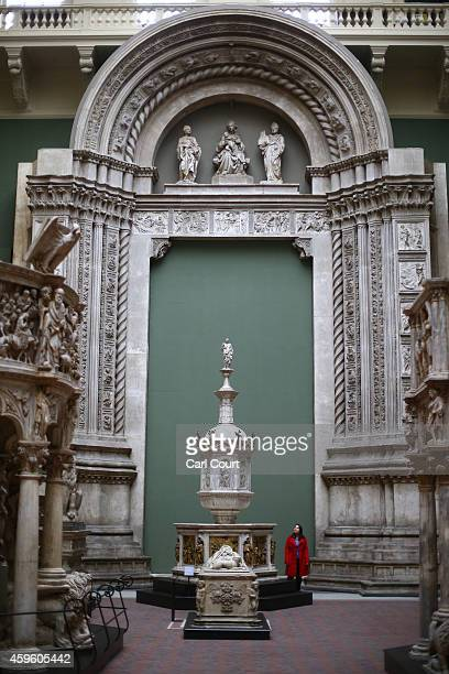 A visitor views exhibits during a press preview for the newly renovated Weston Cast Court at the Victoria and Albert Museum on November 26 2014 in...